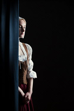 Magdalena Russocka historical woman servant behind curtain inside