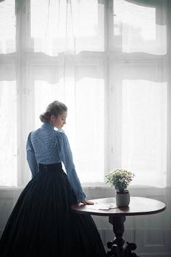 Ildiko Neer Victorian woman standing by window