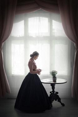 Ildiko Neer Victorian woman reading letter by window Women