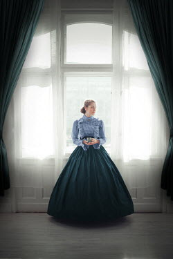 Ildiko Neer Victorian woman holding cup at window