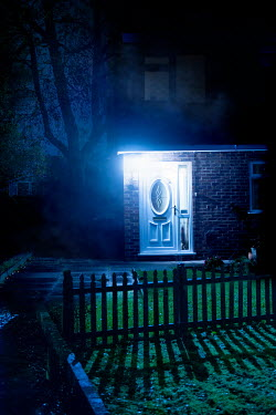 Lee Avison suburban house with illuminated front door at night