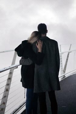 Miguel Sobreira YOUNG COUPLE HUGGING ON BRIDGE Couples