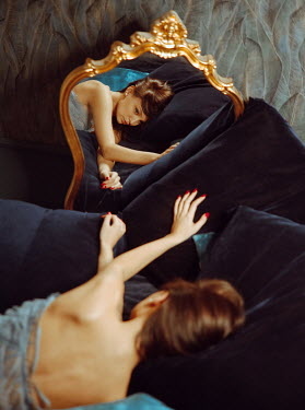 Rafael Sanchez Garcia BRUNETTE WOMAN REFLECTED IN MIRROR LYING ON SOFA Women