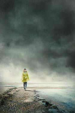 Silas Manhood GIRL WALKING BY SEA WITH STORMY SKY Women