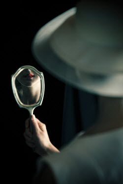 Natasza Fiedotjew red lips of vintage woman reflected in hand mirror