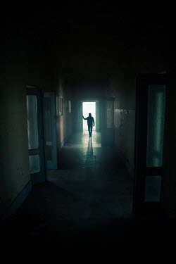Natasza Fiedotjew silhouette of man in corridor of building Men