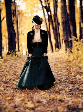 Elisabeth Ansley HISTORICAL WOMAN WALKING IN AUTUMN COUNTRYSIDE Women