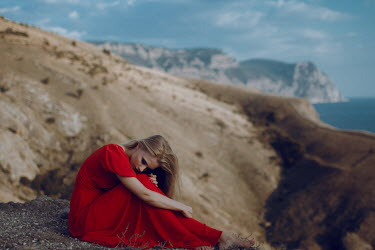 Irina Orwald WOMAN IN RED DRESS ON CLIFFS BY SEA Women