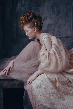 Irina Orwald WOMAN WITH AUBURN HAIR SITTING IN IN PINK GOWN Women