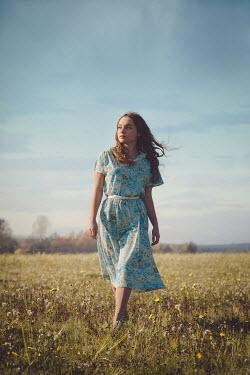 Joanna Czogala GIRL IN FLORAL DRESS IN SUMMERY COUNTRYSIDE Women