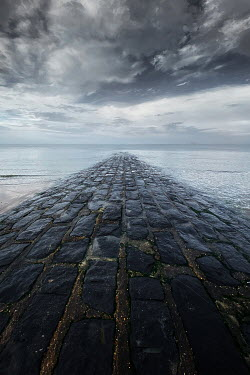 Maria Petkova STONE JETTY AND SEA WITH STORMY SKY Seascapes/Beaches