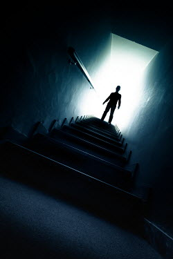 Paolo Martinez SILHOUETTED MAN ON STAIRCASE IN BUILDING Men