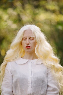 Jovana Rikalo WOMAN WITH CLOSED EYES AND LONG BLONDE HAIR OUTDOORS Women