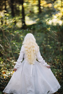Jovana Rikalo WOMAN WITH LONG BLONDE HAIR IN SUMMERY FOREST Women