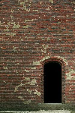 Lisa Bonowicz EMPTY DOORWAY IN RED BRICK BUILDING Miscellaneous Buildings
