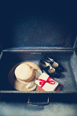 Marie Carr Sun hat, shoes, and envelopes in open suitcase