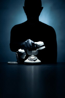 Paolo Martinez Silhouette of man answering telephone