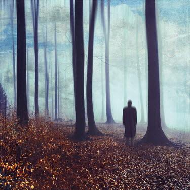 Dirk Wustenhagen Man in coat standing in foggy forest