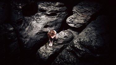 Elisabeth Mochner Woman sitting on rocks and crying