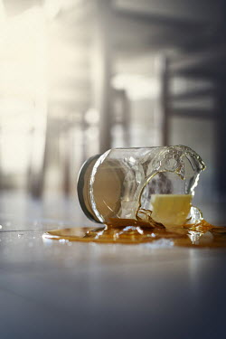 Paolo Martinez Broken jar of honey on tiled floor