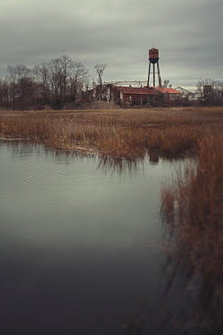 Lisa Bonowicz Rusted water tower by pond