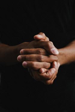 Matilda Delves Hands of young man