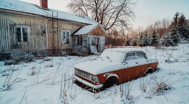 Rafael Sanchez Garcia Vintage car and cabin under snow