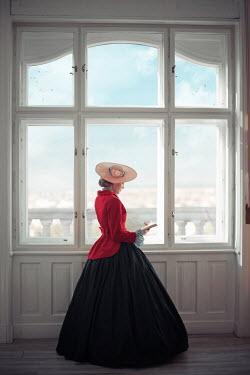 Ildiko Neer Victorian woman reading by window