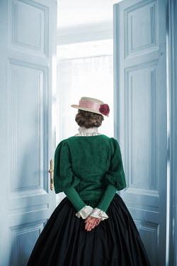 Ildiko Neer Victorian woman standing by doors