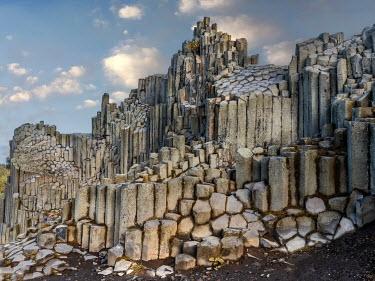 Jaroslaw Blaminsky Basalt columns under clouds
