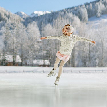Lilia Alvarado Girl ice skating on frozen lake