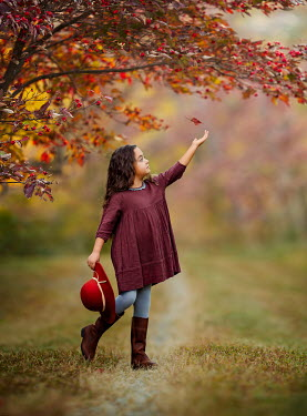 Lilia Alvarado Girl catching falling autumn leaf