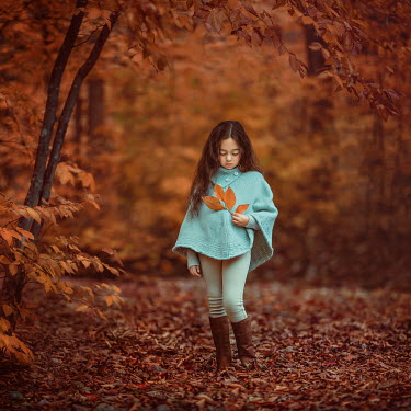 Lilia Alvarado Girl in blue coat holding autumn leaf