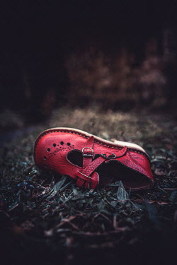 Marie Carr Child's red shoe discarded on grass