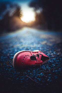 Marie Carr Child's red shoe discarded on road
