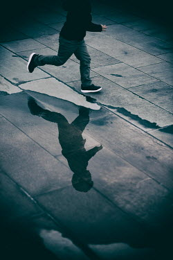 Mohamad Itani Running boy and his reflection in puddle