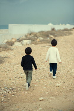 Mohamad Itani Boys walking on beach