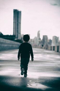 Mohamad Itani Boy walking on footpath