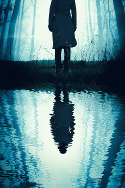 Magdalena Russocka Teenage girl and her reflection in forest puddle
