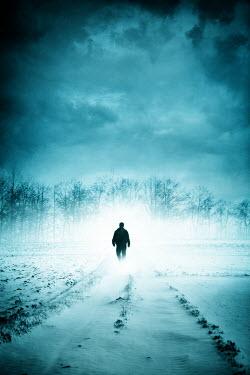 Magdalena Russocka silhouette of man walking in snowy field