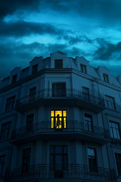 Magdalena Russocka silhouette of woman in balcony door of historical building at night