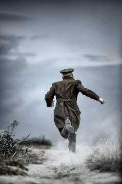 Magdalena Russocka Soldier running on dusty road