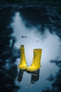 Magdalena Russocka yellow child's wellies abandoned in puddle
