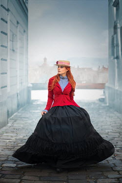 Ildiko Neer Historical woman walking on cobbled street