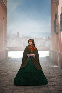 Ildiko Neer Historical woman standing in old town
