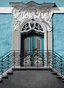 Jaroslaw Blaminsky Door and steps with railing to blue mansion