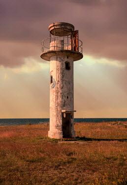 Jaroslaw Blaminsky Abandoned lighthouse at sunset
