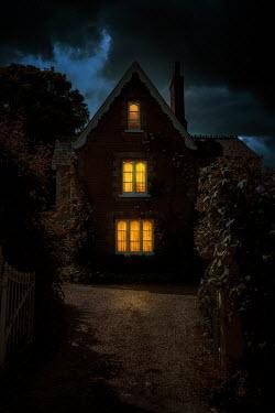 Nic Skerten LIGHTS SHINING IN HISTORICAL HOUSE AT NIGHT Houses
