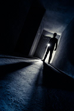 Paolo Martinez SILHOUETTED MAN STANDING IN DARK BUILDING Men