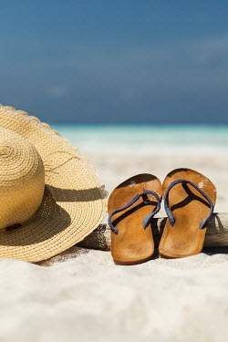 Paolo Martinez FLIP FLOPS AND STRAW HAT ON SANDY BEACH Miscellaneous Objects